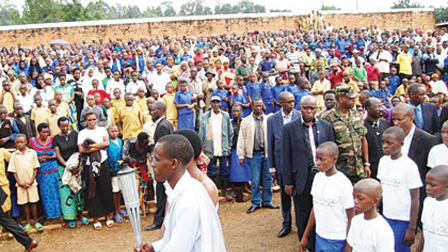 The Kwibuka Flame as it arrived in Rusizi stadium last Friday. Residents stood up in respect as the Flame made its way into the stadium where hundreds of Tutsis were killed during ....