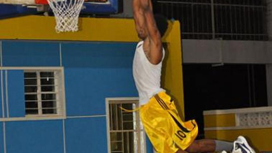 New Espoir signing Mike Buzangu goes for a slam dunk during a practice session. He is one of the most entertaining players in the local league. Plaisir Muzogeye.