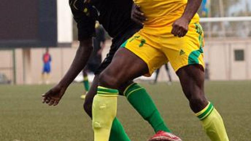Jimmy Mbaraga (R) battles for ball possesion with an Academie Tchite defender during the first leg. Timothy Kisambira.
