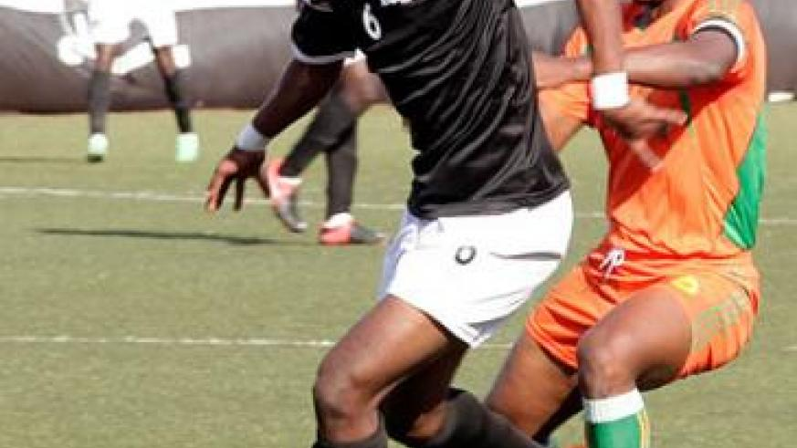Yannick Mukunzi, left, seen here against Gicumbi in the first round match, is expected to start in APR midfield in the absence of suspended Andrew Buteera. Timothy Kisambira