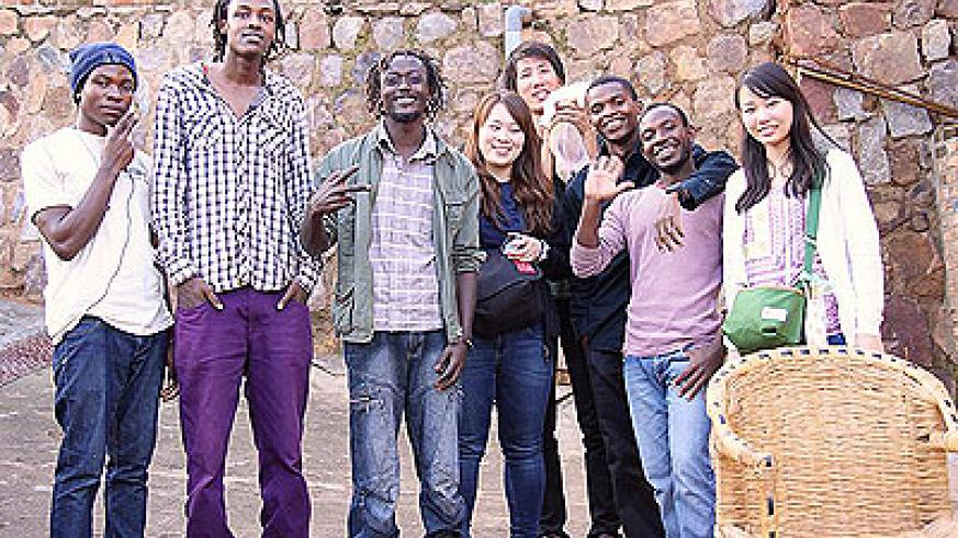 Niyonnkuru (2nd -L) at Ivuka Arts Centre with his colleagues.