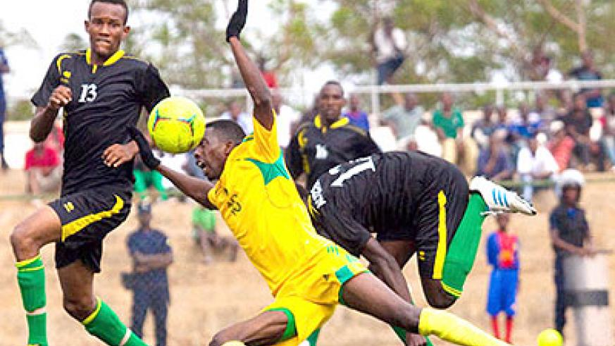 AS Kigali striker Bodo Ndikumana goes down after a challenge by an Academie Tchité player at Stade de Kigali in the previous round.  Timothy Kisambira.
