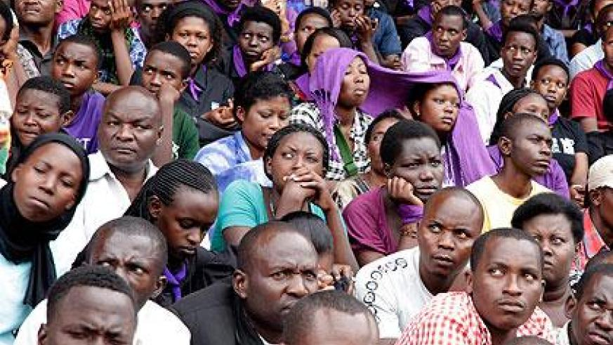 People listening to testimonies during a commemoration ceremony at Amahoro Stadium in 2012. File