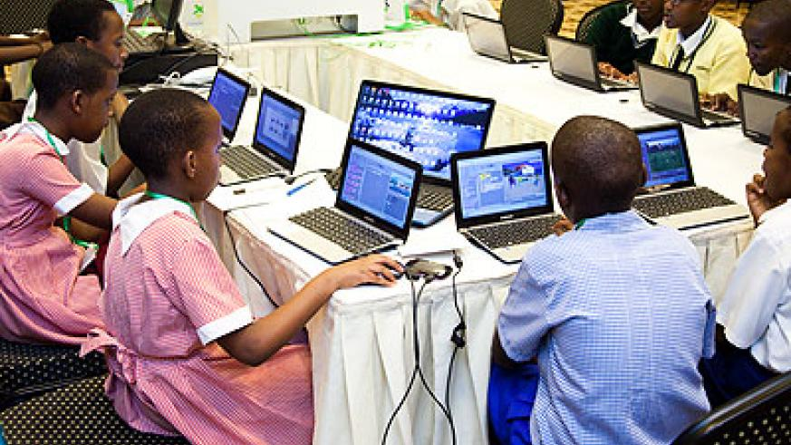 Pupils doing some work on their laptops. In Rwanda today, both girls and boys have access to the same facilities in schools. /Timothy Kisambira