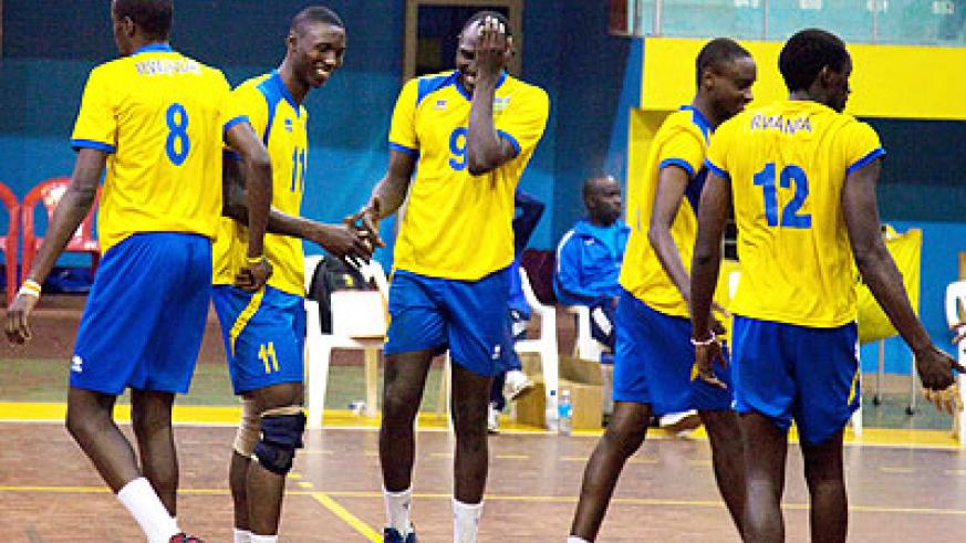 Rwandan internationals, Yakan Lawrence Guma, middle, and Christophe Mukura, #12, will be affected by the Algerian V-ball federation decision. (File)