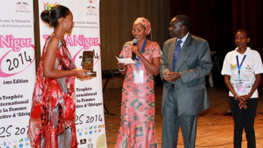 Rugwizangoga (left) receives her award at the ceremony held in Niger earlier this week. Courtesy.