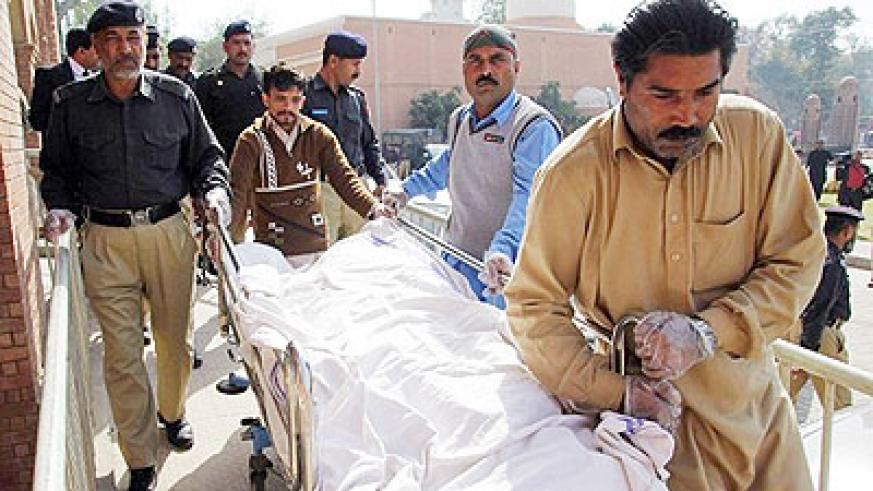 SEXUAL VIOLENCE. Pakistani paramedics and policemen move the body of a rape victim from a hospital in Multan. A Pakistani teenager died on March 14 after setting herself on fire af....