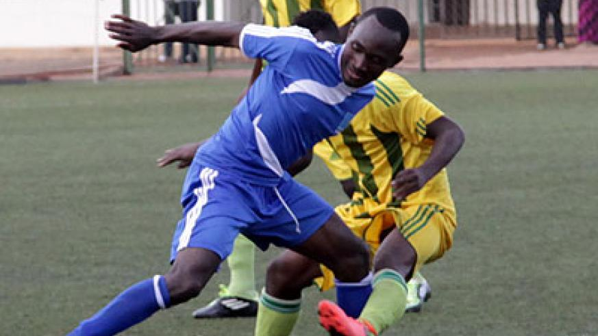 Cedric Amissi with the ball scored a hat-trick to help Rayon Sport advance to the next round of 2014 Peace Cup. John Mbanda.