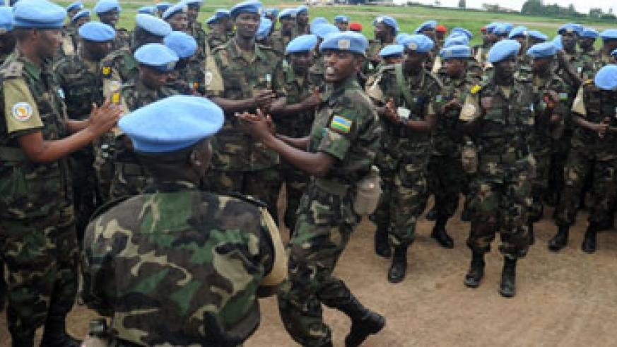 BRAVO RDF Soldiers in a morale-boosting session on arrival from a peacekeeping mission in Darfur in 2012.  The country's peacekeepers have been lauded for helping to pacify the v....
