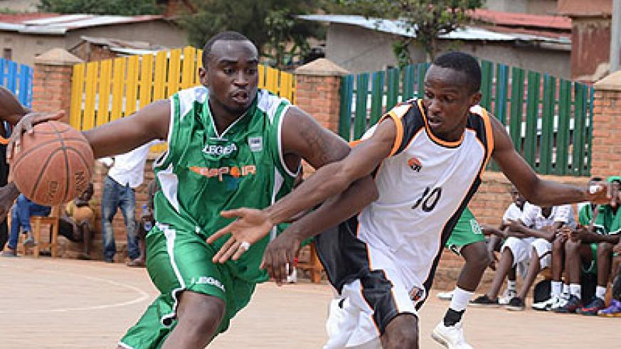 Espoir's Pascal Karekezi, left, tries to drive past an APR opponent during a previous game two weeks ago. File.