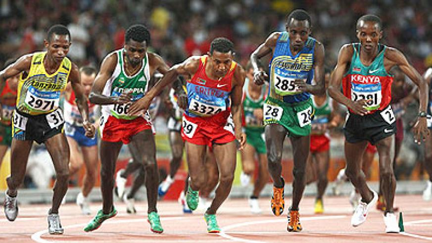 Dieudonne Disi, 2nd from right, seen here competing in the 10,000m finals during the 2008 Beijing Olympics, will lead Rwanda's medal quest in Glasgow. File