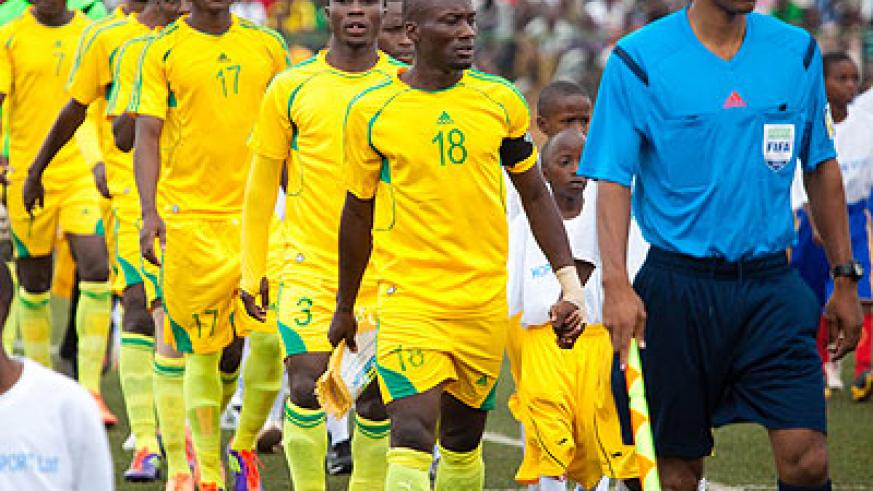 AS Kigali skipper Jimmy Mbaraga (#18) leads his teammates onto the field on Saturday for the first leg clash at the Kigali Regional Stadium. (Timothy Kisambira)