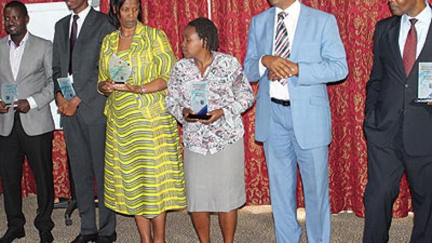 The winners pose for a photo after the awards ceremony on Friday. (Solomon Asaba)