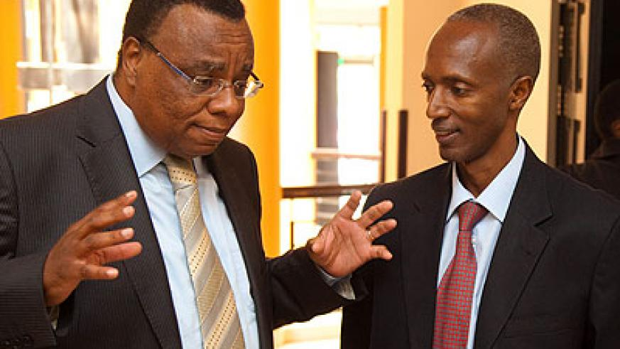 Kenyan High Commissioner to Rwanda John Mwangem (L), chats with the Director General of Immigration and Emigration, Anaclet Kalibata, at the meeting at Lemigo Hotel yesterday. (Tim....