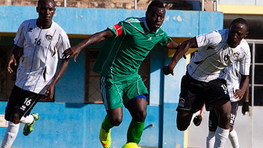 Kiyovu striker and captain Julius Bakabulindi, center, seen here playing against APR in a previous league match, will be biggest threat for Police defenders this afternoon. (Timoth....