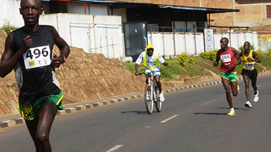 Alex Nizeyimana, seen here leading the pack on his way to winning last year's edition of the MTN-Kigali half marathon, will be Team Rwanda's best bet for a good finish. (Timoth....