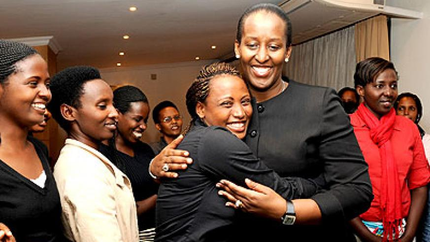 First Lady Jeannette Kagame with young Genocide survivors. (Courtesy)