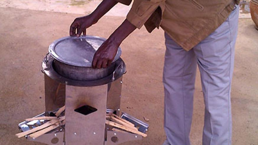 A man shows how a 'Save80' cooking stove is used. (Athan Tashobya)