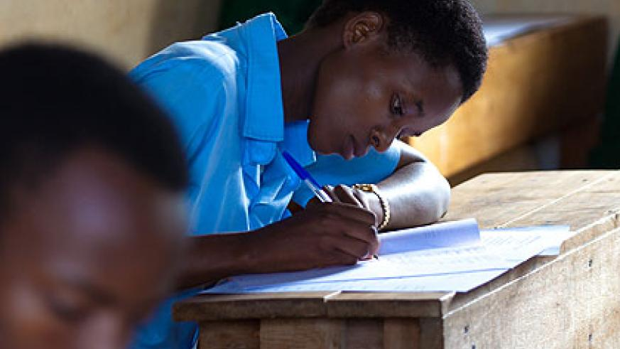 Students in Rwamagana District sit an exam. Up to 68 per cent of the population can read and write. (Timothy Kisambira)