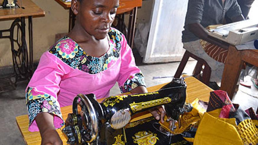 Dusangiyitegeko sews clothes. Her clientele base has grown because of the quality of her work. (Jean d'Amour Mbonyinshuti)