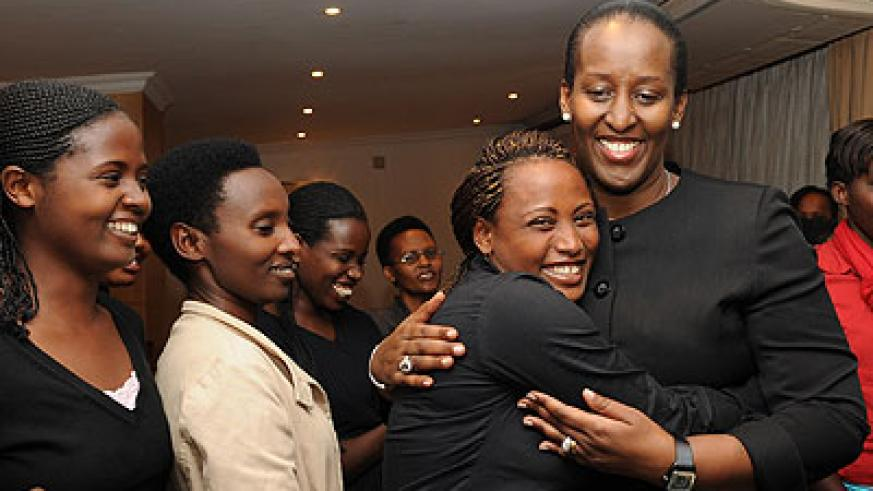The First Lady, Jeannette Kagame, with young survivors at a past event. (File)