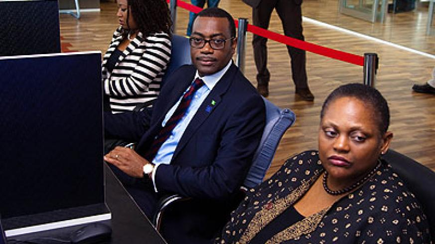 Adesina (C) and Jendayi Frazer, the EAX board chair (R) at EAX in kigali on Wednesday. (Timothy Kisambira)