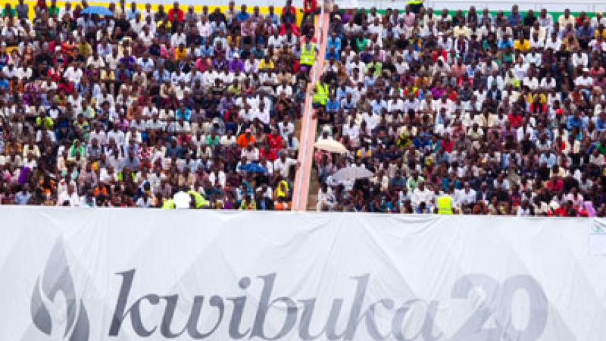 Rwandans attend the 20th commemoration of the Genocide against the Tutsi at Amahoro Stadium on Monday. (Timothy Kisambira)
