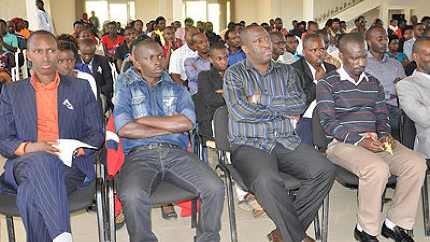Some mourners at Tumba College of Technology during the commemoration event last week. Jean d'Amour Mbonyinshuti.