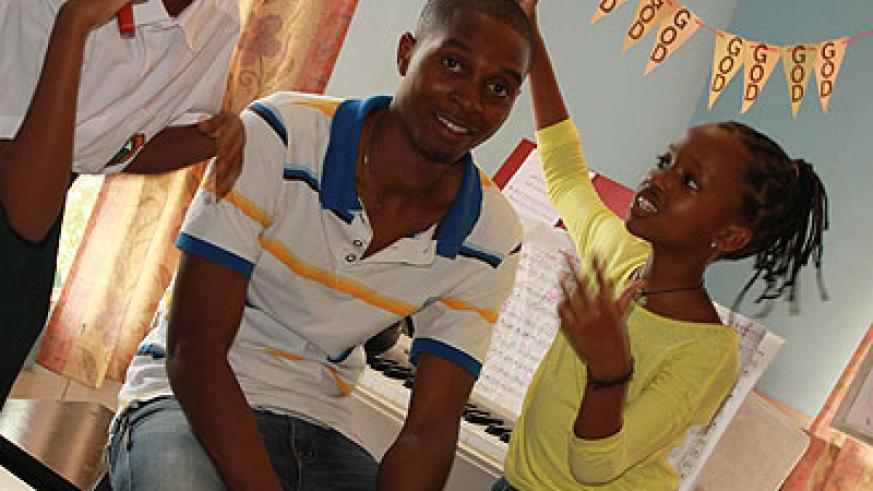 Bizimana with one of his students. (Moses Opobo)