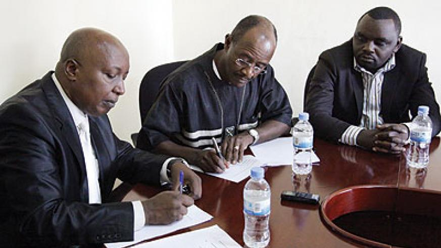 Nzeyimana (left) and Ciano sign the tenancy deal documents as another official looks on. The New Times/John Mbanda.