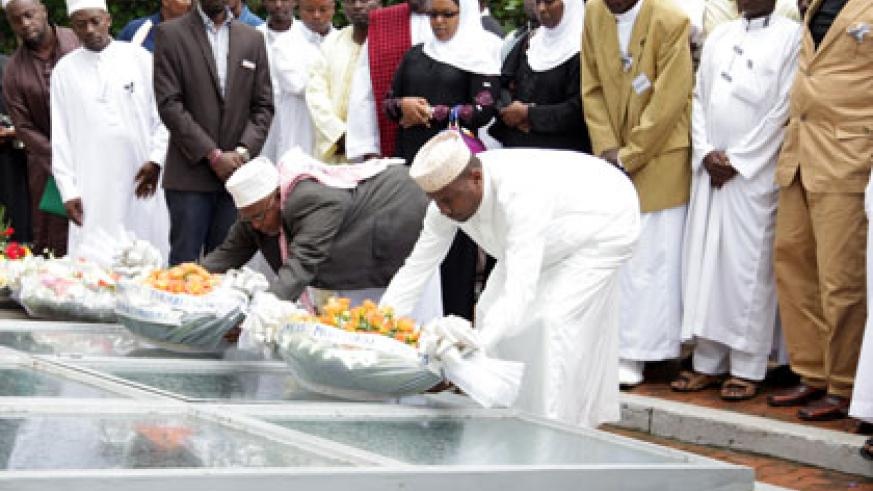 Muslims pay tribute to Genocide victims at Kigali Genocide memorial yesterday. John Mbanda.