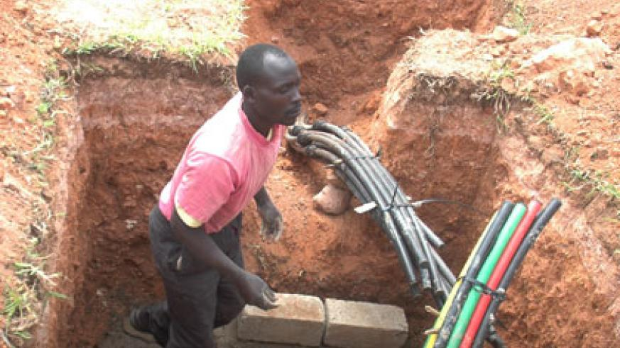A worker lays fibre optic cables. Rwanda has invested in broadband infrastructure, including the laying of fibre optic cables across the country. File.