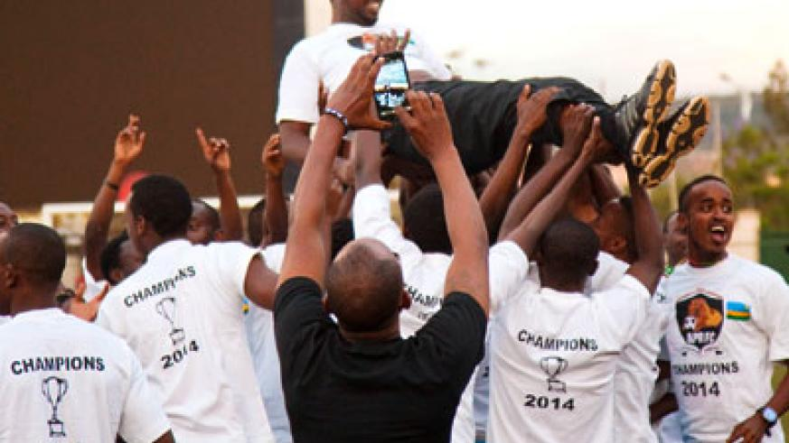 APR head coach Vincent Mashami is lifted in the air by players after winning the Turbo King Football League title on Sunday. Timothy Kisambira.