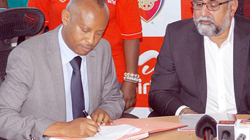 Ferwafa Vice president Vedaste Kayiranga and Airtel Rwanda Managing Director Teddy Bhullar sign the agreement.