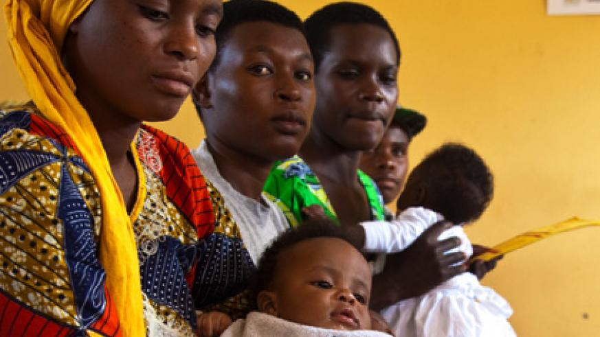 Mothers await medical service at a health centre in Kigali. Rwanda has hit the MDG target on maternal health. File.