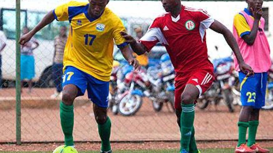 Striker Maxime Sekamana seen dribbling past a Burundian defender in a past friendly match will be key for Rwanda when they host Gabon this afternoon in Kigali. (Timothy Kisambira)