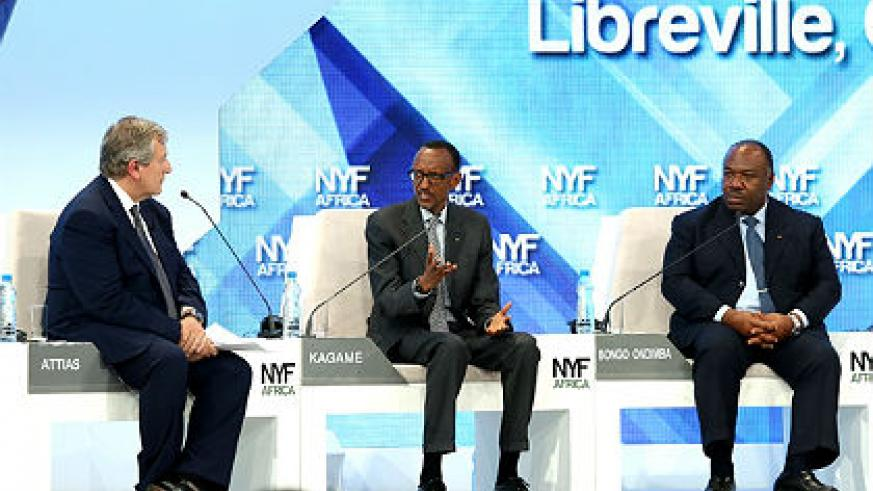 President Kagame addresses the African Citizen's Summit session at The New York Forum Africa 2014 in Libreville, Gabon yesterday. Looking on are President Ali Bongo Ondimba of Gabon (R) and Moroccan Businessman Richard Attias. (Village Urugwiro)