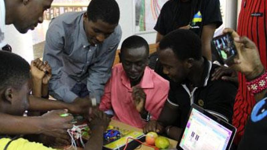 Students use a portable lab to develop IT solutions . (Patrick Buchana)