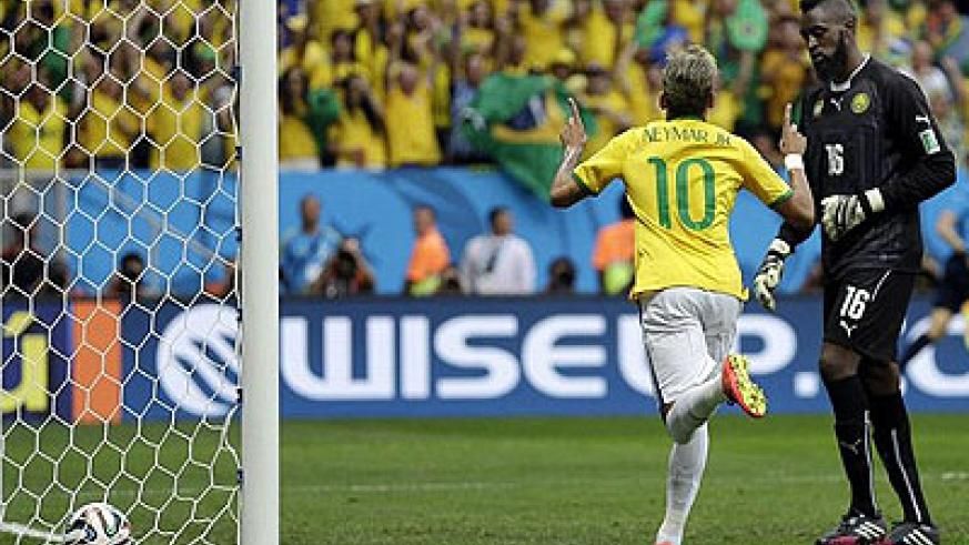 Neymar scored twice to help put Brazil into the last 16 of the 2014 World Cup as his side swept aside Cameroon on Monday night. Net Photo