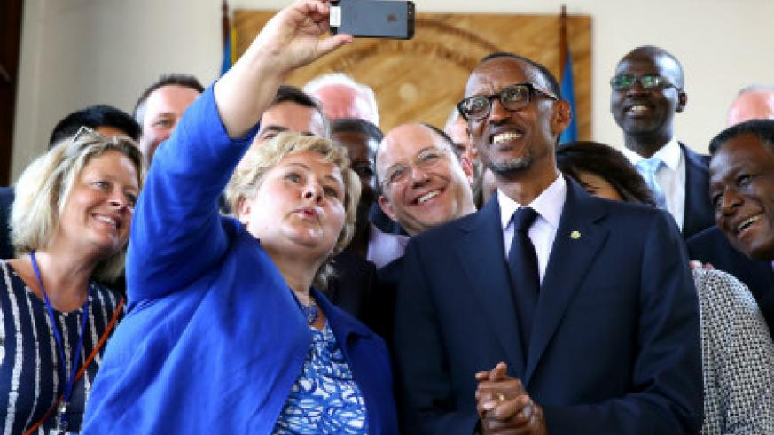President Kagame and the Prime Minister of Norway, Erna Solberg, during the MDG Advocacy Group meeting in Kigali on Thursday. (Village Urugwiro)