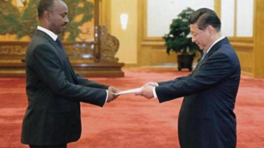 Amb. Chharles Kayonga presents credentials to President Xi Jinping. (Paul Ntambara)