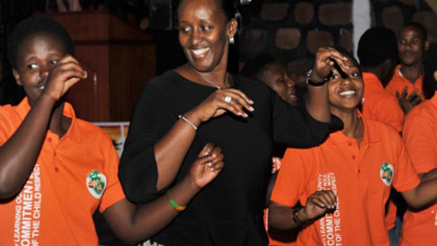 First Lady Jeannette Kagame shares a light moment with Agahozo Shalom children. (Courtesy)