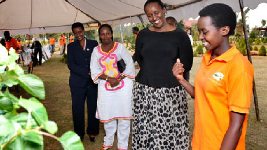 The First Lady listens to a student at Agahozo-Shalom Youth Village in Rwamagana on Thursday. She was accompanied by the Minister for Gender and Family Promotion, Oda Gasinzigwa (L), and the Governor, Eastern Province, Odette Uwamariya. Courtesy.