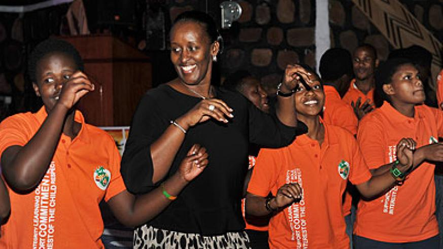 The First Lady joins Agahozo-Shalom Youth Village children in a traditional dance during the fundraiser on Thursday. Courtesy.