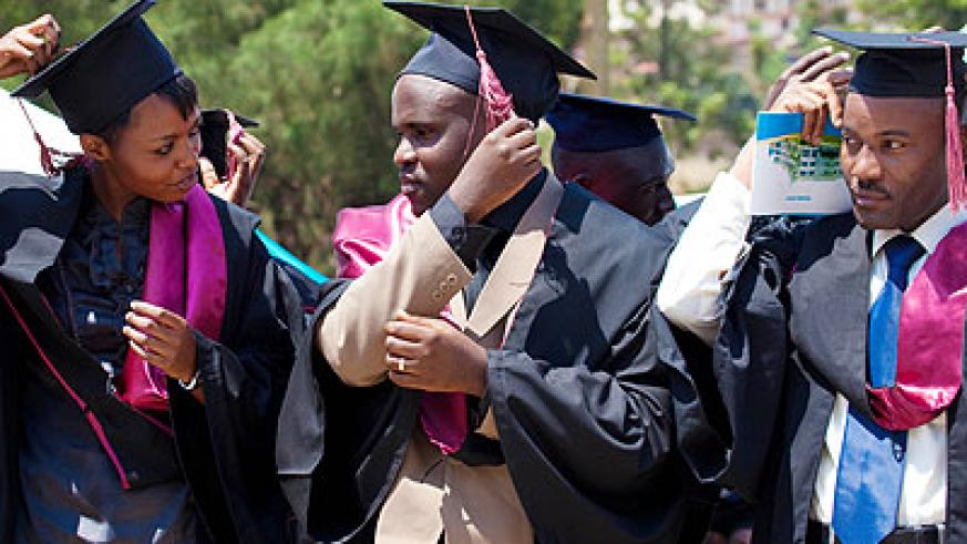 Graduates during a past graduation ceremony. There is a requirement that students need to carry out a research project to be awarded their degrees. File.