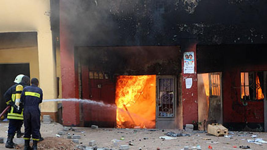 Firefighters try to contain a blaze at Quartier Mateus last week. John Mbanda.
