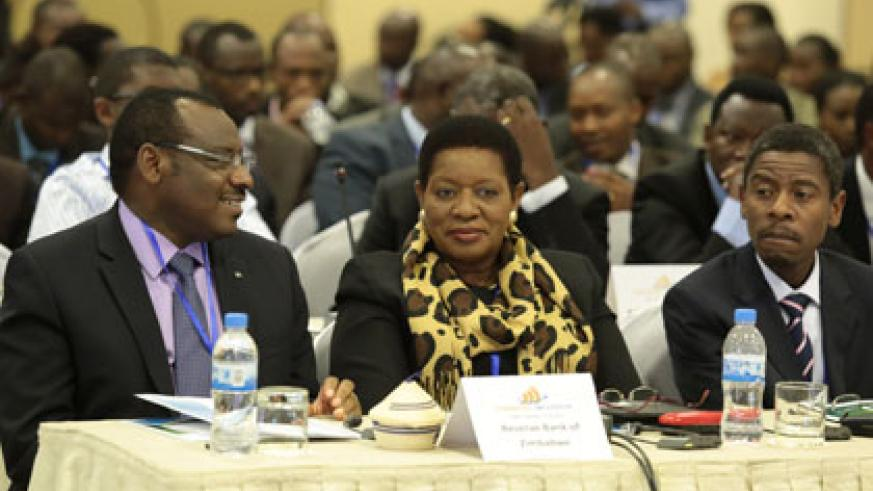 Finance minister Claver Gatete (L) and other dignitaries at the Financial Inclusion for Inclusive Growth and Sustainable Development Summit in Kigali yesterday. John Mbanda.