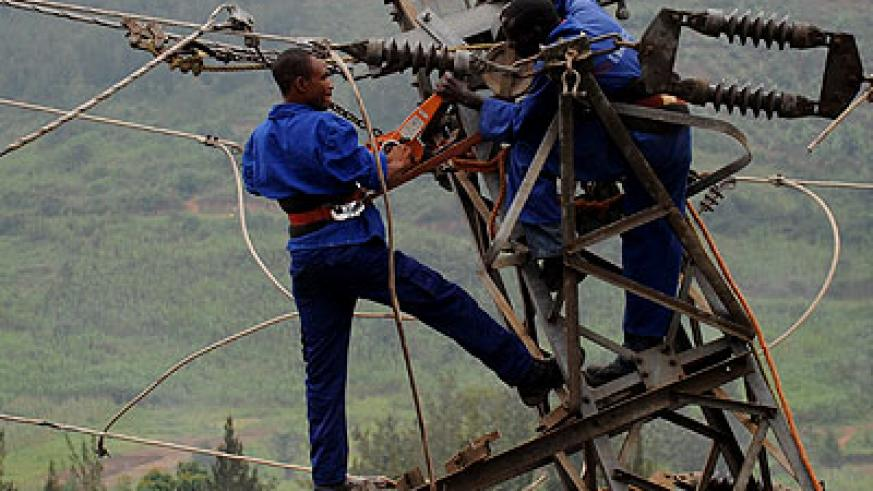 EWSA technicians fix a power line. The agency has been faulted for disrgarding AG's past recommendations.  File.