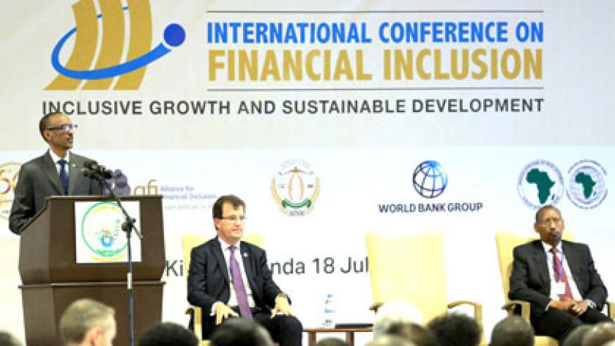 President Kagame addresses the Financial Inclusion summit in Kigali yesterday. Looking on are the World Bank Group Chief Financial Officer, Bertrand Badré (centre), and the Governor,  National Bank  of Rwanda, John Rwangombwa. Village Urugwiro.