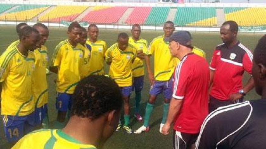 Amavubi head coach Stephen Constantine gives tips to his players before taking them in yesterday's evening drills in preparation for today's crunch qualifier in Pointe-Noire. (Courtesy)